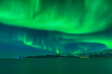 The sky of Norway wrapped by a cloud of aurora borealis