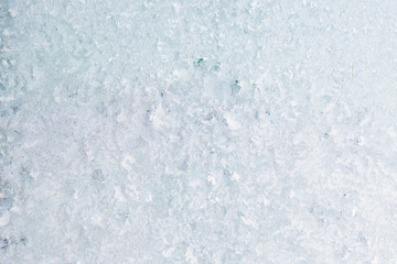 Winter background with gleaming ice. Frozen water texture. Copy space.