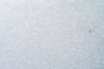 Frozen winter abstract background on the window glass with copy space