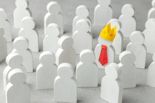 How to choose a leader from the crowd of staff. Lot of people and one special employee in red tie and crown. Staff recruitment