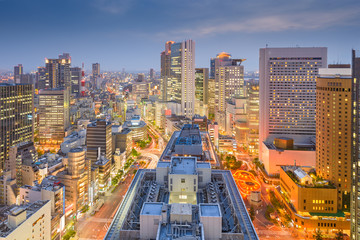 Fototapete - Osaka, Japan downtown city skyline in the Umeda District at dusk.