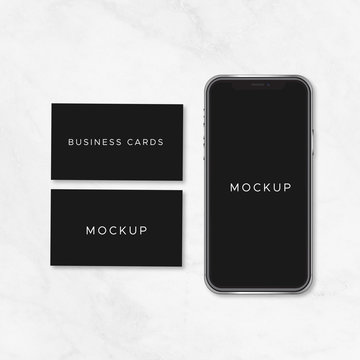 Black business cards and black smartphone mockup vector