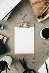 Flat lay of clipboard with copy space blank mock up. Top view home office desk workspace decorated with wooden board, coffee and stationery.