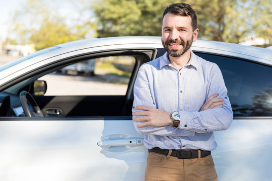 Portrait Of Confident Owner Leaning On New Car