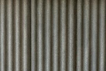 Texture of fiber cement roof sheet. Close up of corrugated wave asbestos tile. Classic style.