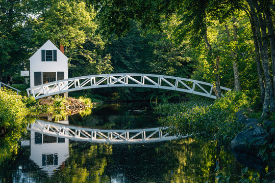 Bridge over a pond and the Selectmen's Building in Somesville, Maine