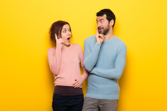 Couple in valentine day intending to realizes the solution while lifting a finger up