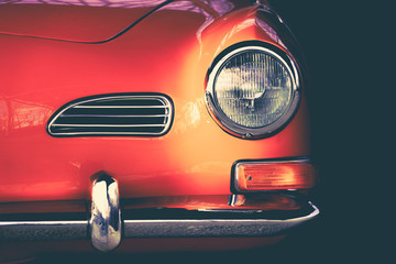 Karmann Ghia orange oldtimer shown to the detail in artistic way