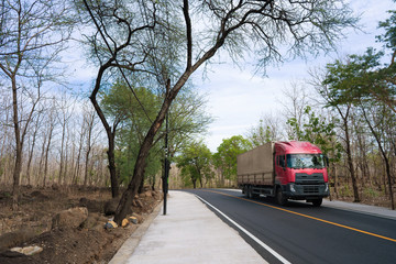 trailer truck in countryside road