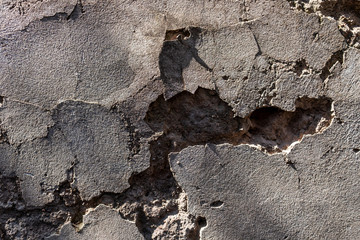 old stone wall with cracks