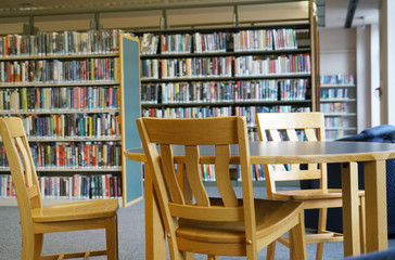 round table in the library in front of book shelves