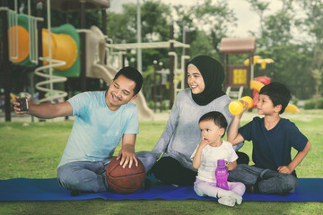 Happy Muslim family takes picture after exercises