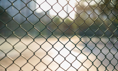 Close-up chain link fence , Sunset background