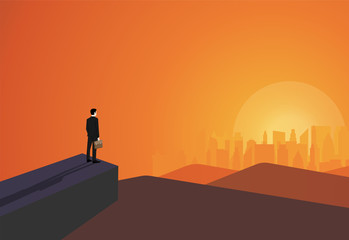 Businessman stand on cliff look at success in the city