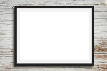 black picture frame on vintage wood background - blank mock-up