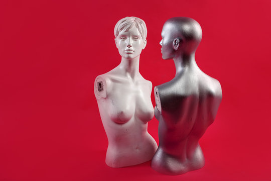 Two mannequins on a pink background. Fashion and design.