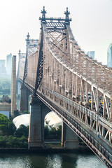 View of Ed Koch Queensboro Bridge that connects Manhattan with Queens on East River during sunny summer day