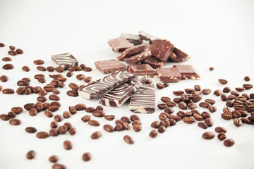 close up.set of chocolate bars and coffee beans. isolated on white.photo with copy space