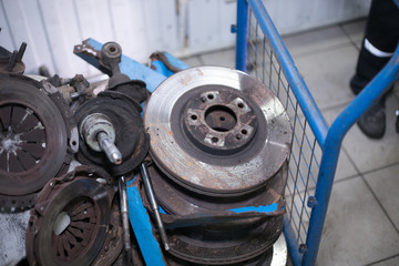 Worn out rusty brake discs and other parts - Image
