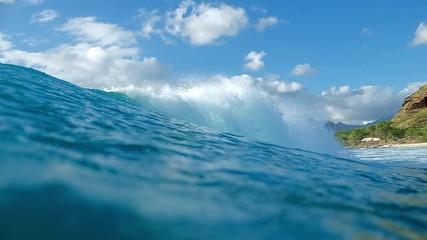 Wall Mural - Ocean wave breaks on shore. Hawaii