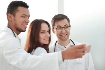 team of doctors interns taking selfies in the lobby of the hospital