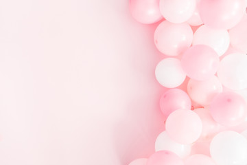 Balloons on pastel pink background. Frame made of white and pink balloons. Birthday, valentines...