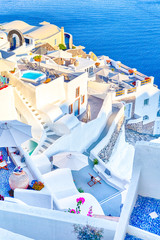 European Destinations. Amazing View of Classic White Houses and Blue Colors of Oia Village Houses And Architecture on Santorini Island in Greece.