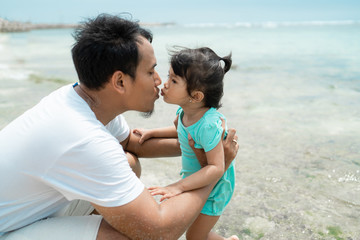 kissing together, sign of daughter loves his father