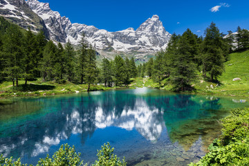 Summer alpine landscape with the Matterhorn (Cervino) reflected on the Blue Lake (Lago Blu) near Breuil-Cervinia, Aosta Valley, northern Italy Wall mural