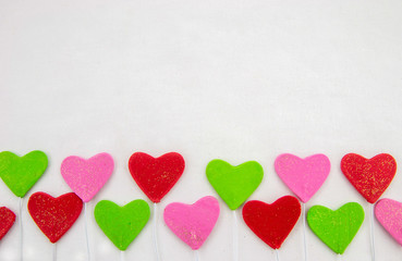 Valentines day decorative background with decorative colorful hearts on a white background. Close up. Top view.