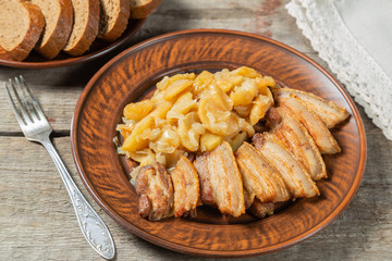 Stew of pork belly with apples, onion and sugar. Aebleflæsk.