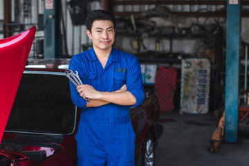 Hand of car mechanic with wrench. at car repair garage at excellent
