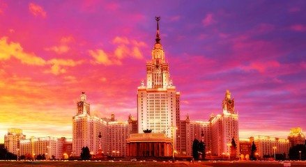 Vbrant wide angle panoramic evening view of illuminated famous Russian university in summer