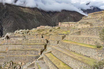 Cusco, Peru - Oct 22, 2018: Stone buildings and terraces at the Ollantaytambo archaeological site in the Sacred Valley
