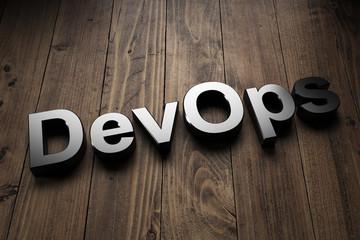 DevOps sign on wooden background