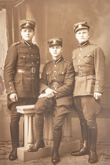 Latvia - 1930s: An antique photo shows three soldiers posing in front of camera