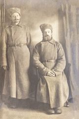 RUSSIA - CIRCA 1916-1917: An antique photo shows two soldiers posing in front of camera