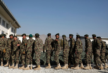 Afghan National Army soldiers attend their graduation ceremony at the Kabul Military Training Centre in Kabul