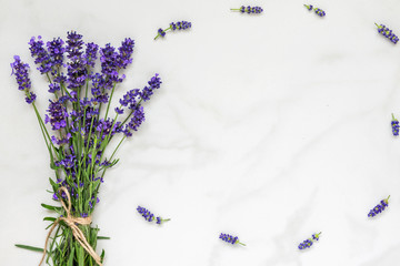 lavender flowers bouquet on white marble table with copy space for your text. top view. flat lay