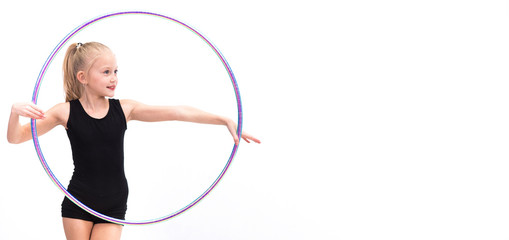 Photo sur Plexiglas Gymnastique Teenager girl involved in rhythmic gymnastics with gymnastic hoop.With space for inscriptions