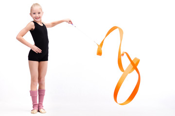 Foto auf Leinwand Gymnastik Beautiful teen girl doing rhythmic gymnastics exercises. White background. Holding a ribbon