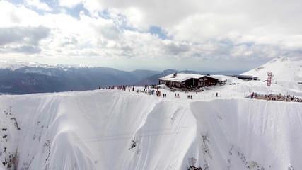 Wall Mural - SOCHI, RUSSIA - JANUARY 10, 2018: Aerial landscape view of Caucasus Mountains in winter in Sochi ski resort in Russia