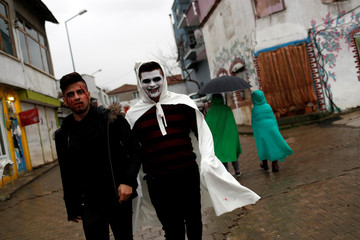 Revelers wearing scary make up walk as they get ready for the Bocuk night, or the Thracian Halloween, in Camlica village, near the western town of Kesan