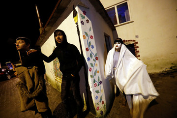 A reveler wearing scary make up spooks residents during the Bocuk night, or the Thracian Halloween, in Camlica village, near the western town of Kesan