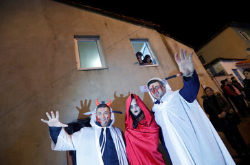Revelers wearing scary make up spook residents during the Bocuk night, or the Thracian Halloween, in Camlica village, near the western town of Kesan