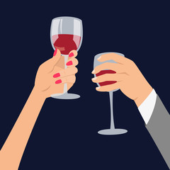 Hands holding a glasses with red wine.