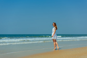 Beautiful Girl in White Dress Enjoy and Relax on The Beach. Travel and Vacation.