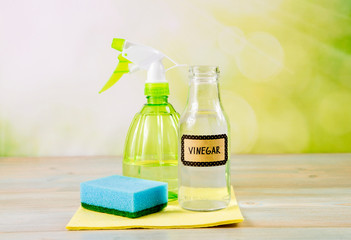 Chemical free home cleaner products concept. Using natural destilled white vinegar in spray bottle...