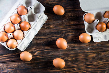 Chicken eggs are in the tray. Fresh chicken eggs in a tray on a rustic wooden table