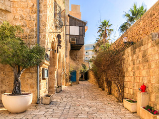 Poster Historical buildings Ancient stone streets in Artists Quarter of Old Jaffa, Israel